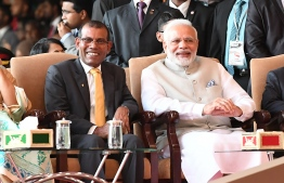 This handout photograph taken and released by India's Press Information Bureau (PIB) on November 17, 2018 shows Indian Prime Minister Narendra Modi (R) seated with former Maldives president Mohamed Nasheed (L), who recently returned from exile, during the inauguration of new Maldives President Ibrahim Mohamed Solih in Male. - Ibrahim Mohamed Solih was inaugurated November 17 as the new president of the Maldives after the opposition united to dislodge pro-China strongman leader Abdulla Yameen in September elections. (Photo by Handout / PIB / AFP) /