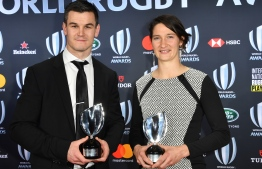 World Rugby Men's 15s Player of the Year award winner Johnny Sexton (L) and World Rugby Women's 15s Player of the Year award winner Jessy Tremouliere from France pose with their trophies during the World Rugby Awards on November 25, 2018 at the Monte-Carlo Sporting Club in Monaco. (Photo by YANN COATSALIOU / AFP)