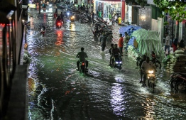 A road of Male City flooded away heavy rainstorms. PHOTO/MIHAARU