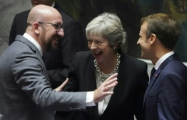 Belgian Prime Minister Charles Michel (L), British Prime Minister Theresa May and French President Emmanuel Macron are seen September 26, 2018 on the second day of the United Nations General Assembly in New York. (Photo by Don EMMERT / AFP)