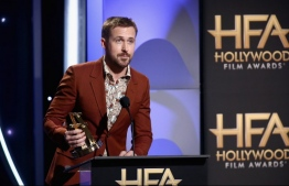 "(FILES) In this file photo taken on November 4, 2018, Ryan Gosling speaks onstage during the 22nd Annual Hollywood Film Awards at The Beverly Hilton Hotel in Beverly Hills, California. - Actor Ryan Gosling is best known for films as diverse as ""La La Land"" and ""First Man"" but he recently moved behind the lens for a passion project -- taking photos in the crisis-hit Democratic Republic of Congo. The 38-year-old Gosling, who is Canadian, is no stranger to advocacy in Africa -- for a decade, he's been working with the Enough Project, which aims to end mass atrocities in the continent's conflict hotspots. On the DRC, he teamed up with the Enough Project's founding director John Prendergast and Congolese activist Fidel Bafilemba to draw attention to the brutal colonization of the central African country. (Photo by Tommaso Boddi / GETTY IMAGES NORTH AMERICA / AFP)"