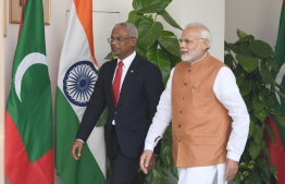 Indian Prime Minister Narendra Modi (R) walks with Maldives President Ibrahim Mohamed Solihas prior to a meeting in New Delhi on December 17, 2018. - Maldivian President is on three-day of state visit to India till December 18. (Photo by Prakash SINGH / AFP)