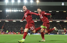 Liverpool's Swiss midfielder Xherdan Shaqiri celebrates with Liverpool's Brazilian midfielder Roberto Firmino (R) after scoring their third goal during the English Premier League football match between Liverpool and Manchester United at Anfield in Liverpool, north west England on December 16, 2018. (Photo by Paul ELLIS / AFP)
