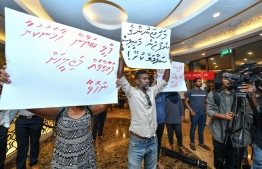Placards held by demonstrators from the  political movement 'Navaanavai' calling to free the parliament from the influence of business tycoons.  PHOTO: NISHAN ALI/MIHAARU