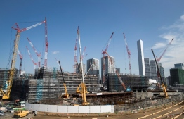 (FILES) This file photo taken on September 5, 2018 shows the Olympic Village under construction, for the upcoming Tokyo 2020 Olympic Games, in Tokyo. - Japan and Tokyo 2020 organisers try to work out how much they will end up spending on the Olympics. Organisers will unveil the latest version of their budget on December 21, 2018 and they face intense pressure to keep costs down. The current budget for the Games -- last updated this time last year -- stands at 1.35 trillion yen (12 billion USD at current exchange rates) and organisers have pledged it will not increase. (Photo by Behrouz MEHRI / AFP)