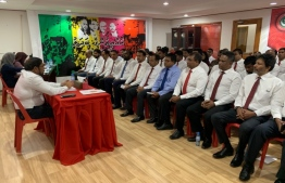 Jumhooree Party (JP) leader Gasim Ibrahim oversees a meeting of the party's council. PHOTO: JP