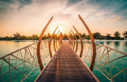 A walkway inspired by whalebones, leading from the island towards an array of lagoon-top restaurants and bars. PHOTO: LUX*