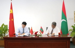 The agreement signing between Maldves and China to renovate Maldivian Foreign Ministry. PHOTO: FOREIGN MINISTRY