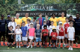 Participating guests alongside Tim Cahill and his coaching staff during the closing ceremony of Amilla Fushi's festive football camp 2018. PHOTO: HAWWA AMANY ABDULLA/THE EDITION