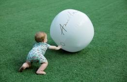 A little toddler playing around Amilla Fushi's football ground. PHOTO: HAWWA AMANY ABDULLA/THE EDITION