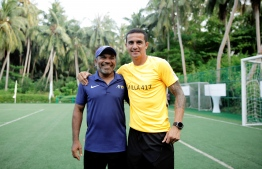 Tim Cahill poses with local coach Ahmed Shareef (Dunga) after the day's festivities. PHOTO: HAWWA AMANY ABDULLA/THE EDITION
