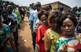 Voters queue to cast their ballots at a symbolic polling station on December 30, 2018, at Malepe Stadium in Beni, where voting was postponed for Democratic Republic of Congo's general elections. - Voters in the Democratic Republic of Congo went to the polls on December 30, 2018 in elections that will shape the future of their vast, troubled country, amid fears that violence could overshadow the ballot. Electoral authorities have postponed the vote until March 2019 in several troubled areas such as Beni and Butembo in North Kivu province (eastern RDCongo), and in Yumbi (western RDCongo). (Photo by ALEXIS HUGUET / AFP)