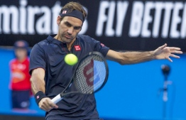 Roger Federer of Switzerland hits a return against Cameron Norrie of Britain during their fourth session men's singles match on day two of the Hopman Cup tennis tournament in Perth on December 30, 2018. (Photo by TONY ASHBY / AFP)
