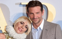 """(FILES) In this file photo US singer/actress Lady Gaga (L) and US actor/director Bradley Cooper pose on the red carpet upon arrival for the UK premiere of the film """"A Star is Born"""" in central London on September 27, 2018. - Hollywood's A-listers will hit the red carpet Sunday for the Golden Globes, the glitzy start to the entertainment industry's awards season, with popular music romance """"A Star Is Born"""" the overwhelming favorite for top honors. (Photo by Anthony HARVEY / AFP)"""