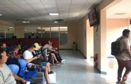 Passengers in the waiting area of Hanimaadhoo Airport. PHOTO/MIHAARU