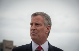 (FILES) In this file photo taken on April 17, 2017 New York Mayor Bill de Blasio speaks after riding the NYC Ferry boat named Lunch Box as he welcomes the first of the new NYC ferry boats to New York Harbor, in New York. - New York City Mayor Bill de Blasio on January 9, 2019, unveiled a proposal to require companies to give employees 10 days of paid time off, in what would be a first for the United States. Currently, no US city or state, or the federal government, requires firms to offer paid leave -- making the US unique among developed countries. Only publicly traded companies are obligated to do so in certain cases. (Photo by Bryan R. Smith / AFP)