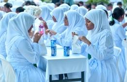 Aminiya School students eating at the inauguration of the breakfast provision policy.