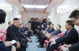 "This January 9, 2019 picture released by North Korea's official Korean Central News Agency (KCNA) on January 10 shows North Korea's leader Kim Jong-Un (2nd L) chatting with Song Tao, head of the International Liaison Department of the Central Committee of the Communist Party of China (2nd R) in a train after their departure from the Beijing station. (Photo by KCNA VIA KNS / KCNA VIA KNS / AFP) / - South Korea OUT / REPUBLIC OF KOREA OUT   ---EDITORS NOTE--- RESTRICTED TO EDITORIAL USE - MANDATORY CREDIT ""AFP PHOTO/KCNA VIA KNS"" - NO MARKETING NO ADVERTISING CAMPAIGNS - DISTRIBUTED AS A SERVICE TO CLIENTS THIS PICTURE WAS MADE AVAILABLE BY A THIRD PARTY. AFP CAN NOT INDEPENDENTLY VERIFY THE AUTHENTICITY, LOCATION, DATE AND CONTENT OF THIS IMAGE. /"