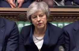 A video grab from footage broadcast by the UK Parliament's Parliamentary Recording Unit (PRU) shows Britain's Prime Minister Theresa May reacting as Labour Party leader Jeremy Corbyn informs the MPs that he has tabled a vote of no confidence in the Government in the House of Commons in London on January 15, 2019, after MPs voted to reject the government's Brexit deal. - British lawmakers voted overwhelmingly Tuesday to reject the EU divorce deal struck between London and Brussels, in a historic vote that leave Brexit hanging in the balance. (Photo by HO / PRU / AFP) /
