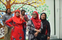 A trio of women at a polling place during the Maldivian Democratic Party parliamentary primaries. PHOTO: NISHAN ALI/MIHAARU