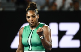 Serena Williams of the US reacts after a point against Romania's Simona Halep during their women's singles match on day eight of the Australian Open tennis tournament in Melbourne on January 21, 2019. (Photo by Jewel SAMAD / AFP)