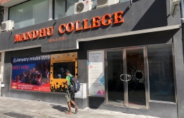 The main entrance door of Mandhu College was broken after the college's chairman, Ibrahim Ismail, was accused of blasphemy.