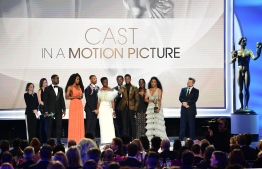 "Chadwick Boseman and the cast of ""Black Panther"" accept the award for best Cast In A Motion Picture during the 25th Annual Screen Actors Guild Awards show at the Shrine Auditorium in Los Angeles on January 27, 2019. (Photo by Frederic J. Brown / AFP)"