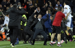 Valencia's coach Marcelino (C) celebrates as his team scores a third goal in extra time during the Spanish Copa del Rey (King's Cup) quarter-final second leg football match between Valencia and Getafe at the Mestalla stadium in Valencia on January 29, 2019. (Photo by JOSE JORDAN / AFP)