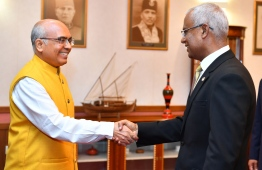 Ambassador of India to Maldives shaking hands with President Ibrahim Mohamed Solih. PHOTO: PRESIDENT'S OFFICE