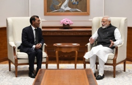 Former president and leader of Maldivian Democratic Party (MDP), Mohamed Nasheed (L), meet with the Prime Minister of India, Narendra Modi, on February 15, 2019.