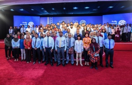 Participants of the Business Convention posing for a photo with Economic Minister. PHOTO: AHMED NISHAATH / MIHAARU