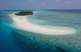 Hanifaru Island as pictured with a paddler from the Stand Up For Our Seas team. PHOTO: BIOSPHERE RESERVE MALDIVES.BAA ATOLL