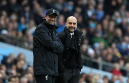 Manchester City Manager Pep Guardiola and Jurgen Klopp manager of Liverpool during the English Premier League match at The Etihad Stadium, Manchester . Picture date: March 19th 2017. PHOTO: Lynne Cameron / Sportimage