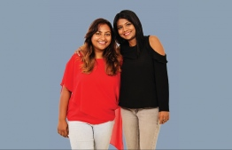 Fazleena Abbas, known better as Angie and one of the first female DJ's in Maldives Angie, smiles beside her cousin and life long friend Reesha Shareef or Iyya, a TV producer at PSM. PHOTO: HAWWA AMAANY ABDULLA / THE EDITION