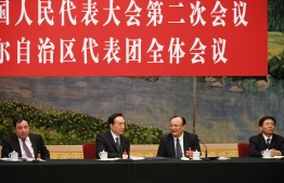 This photo taken on March 12, 2019 shows Xinjiang leaders during the Xinjiang delegation meeting at the National People's Congress at the Great Hall of the People in Beijing. From left are Shewket Imin, Director of the Standing Committee of the People's Congress of Xinjiang, Xinjiang Communist Party Secretary Chen Quanguo, chairman of Xinjiang's government, Shohrat Zakir, and Sun Jinlong, Deputy Secretary of the Party Committee of Xinjiang. (Photo by GREG BAKER / AFP)