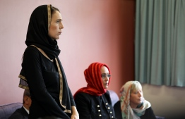 This hand out picture released by the office of New Zealand Prime Minister shows New Zealand Prime Minister Jacinda Ardern meeting with the representatives of the refugee centre during a visit to the Canterbury Refugee Centre in Christchurch on March 16, 2019. - A right-wing extremist who filmed himself rampaging through two mosques in the quiet New Zealand city of Christchurch killing 49 worshippers appeared in court on a murder charge on March 16, 2019. (Photo by - / OFFICE OF PRIME MINISTER OF NEW ZEALAND / AFP) /