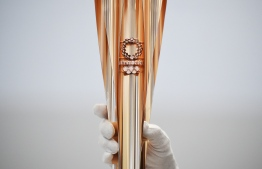 The Tokyo 2020 Olympic Games torch for the torch relay is displayed in Tokyo on March 20, 2019. (Photo by CHARLY TRIBALLEAU / AFP)