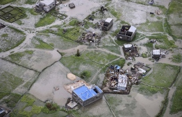 An aerial view a flooded district on the outskirts of the city of Beira, central Mozambique, on March 20, 2019, after the passage of cyclone Idai. - International aid agencies raced on March 20 to rescue survivors and meet spiralling humanitarian needs in three impoverished countries battered by one of the worst storms to hit southern Africa in decades. Five days after tropical cyclone Idai cut a swathe through Mozambique, Zimbabwe and Malawi, the confirmed death toll stood at more than 300 and hundreds of thousands of lives were at risk, officials said. (Photo by ADRIEN BARBIER / AFP)