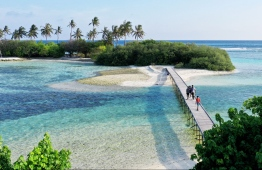 The connective islet 'Lhosfushi' is accessed by a wooden bridge. PHOTO: HAWWA AMAANY ABDULLA / THE EDITION