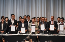 Leaders of Thai political parties show signed documents during a press conference in Bangkok on March 27, 2019. A coalition of seven parties vowed to push back on military-backed parties on March 27, but remain far from forming a majority government as Thai politics remain deadlocked days after its first election since a coup. Lillian SUWANRUMPHA / AFP