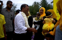 Former President Mohamed Nasheed is warmly welcomed by supporters upon his arrival at GA.Kolamaafushi. PHOTO: HAWWA AMAANY ABDULLA / THE EDITION