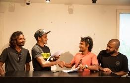 'Raajje Bodyboarding' and Sea Sports during the signing ceremony. (L-R) Ali Javed, Ali Khushruwan, Ahmed Fauzan. PHOTO: RAAJJE BODYBOARDING