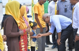 President Ibrahim Mohamed Solih greeting children gathered to welcome him. PHOTO: MDP