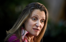 Canada's Foreign Minister Chrystia Freeland speaks to the press while arriving for a meeting of NATO foreign ministers at the US Department of State April 4, 2019, in Washington, DC. (Photo by Brendan Smialowski / AFP)
