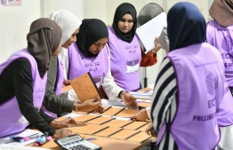 Officials of Elections Commission (EC) at a polling station. PHOTO: HUSSAIN WAHEED / MIHAARU