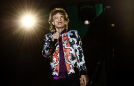 """(FILES) In this file photo taken on June 26, 2018, British musician Mick Jagger of The Rolling Stones performs during a concert at The Velodrome Stadium in Marseille as part of their 'No Filter' tour. - Mick Jagger is """"on the mend"""" after a reportedly successful heart valve procedure in New York, the Rolling Stones frontman said Friday, April 5, 2019. """"Thank you everyone for all your messages of support, I'm feeling much better now and on the mend - and also a huge thank you to all the hospital staff for doing a superb job,"""" said Jagger, 75. Industry tracker Billboard had earlier said doctors performed a minimally invasive transcatheter aortic valve replacement. (Photo by Boris HORVAT / AFP)"""