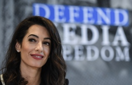 Lebanese-British human-rights lawyer Amal Clooney holds a press briefing on his Media Freedom Campaign on April 5, 2019 in Dinard, western France, in the margins of the G7 Foreign ministers meeting to prepare the G7 Summit in Biarritz. (Photo by Damien MEYER / AFP)