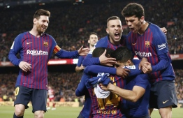 Barcelona players celebrate Barcelona's Uruguayan forward Luis Suarez's goal during the Spanish league football match between FC Barcelona and Club Atletico de Madrid at the Camp Nou stadium in Barcelona on April 6, 2019. (Photo by PAU BARRENA / AFP)