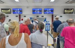 Tourists waiting in queue at Velana International Airport (VIA). PHOTO: NISHAN ALI/ MIHAARU