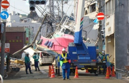 Wreckage of a boat carried into Ishinomaki City by the tsunami, in the 2011 Great East Japan Earthquake and Tsunami. PHOTO: Ishinomaki City/ The Archive of the Great East Earthquake in Miyagi